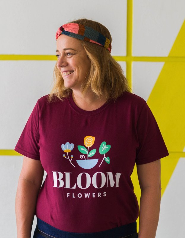 Photo of woman with Bloom Flowers logo t-shirt