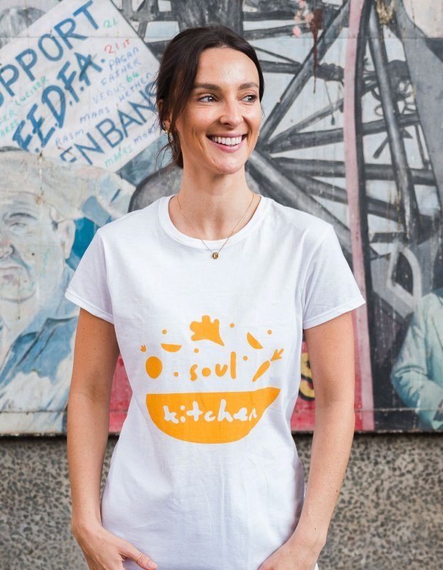 Photo of woman with Soul Kitchen logo t-shirt