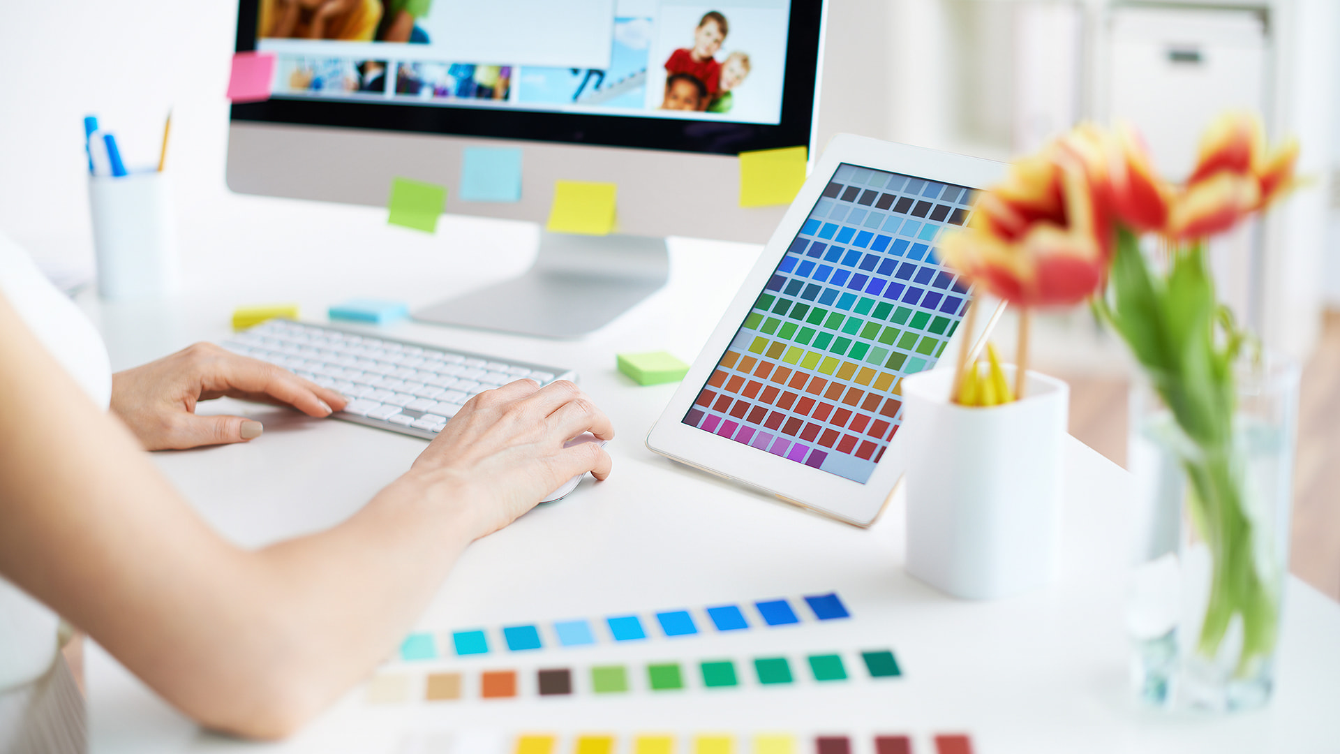 Designer working with colors on her tablet PC