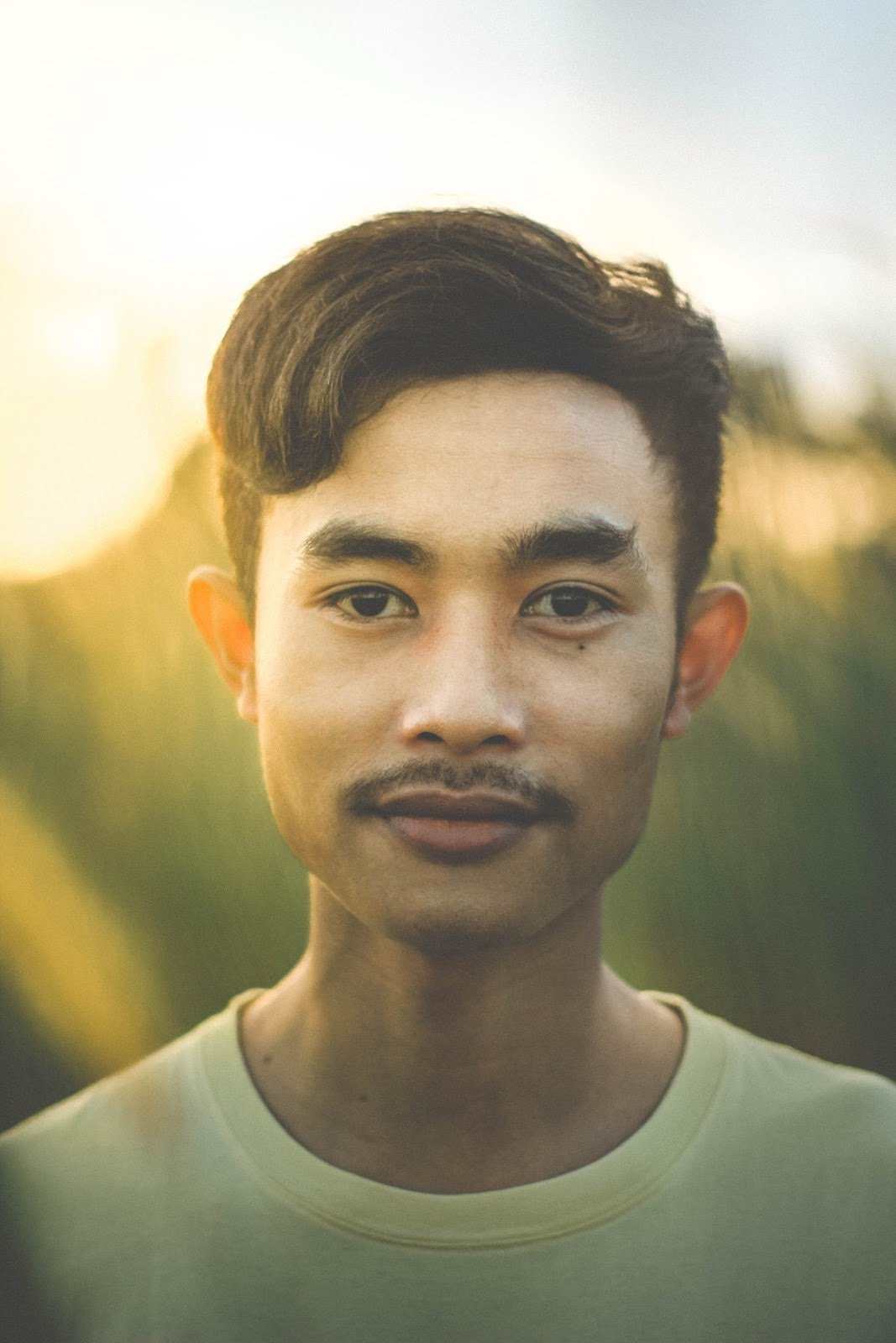 Portrait of a young man during the golden hour by Ajun