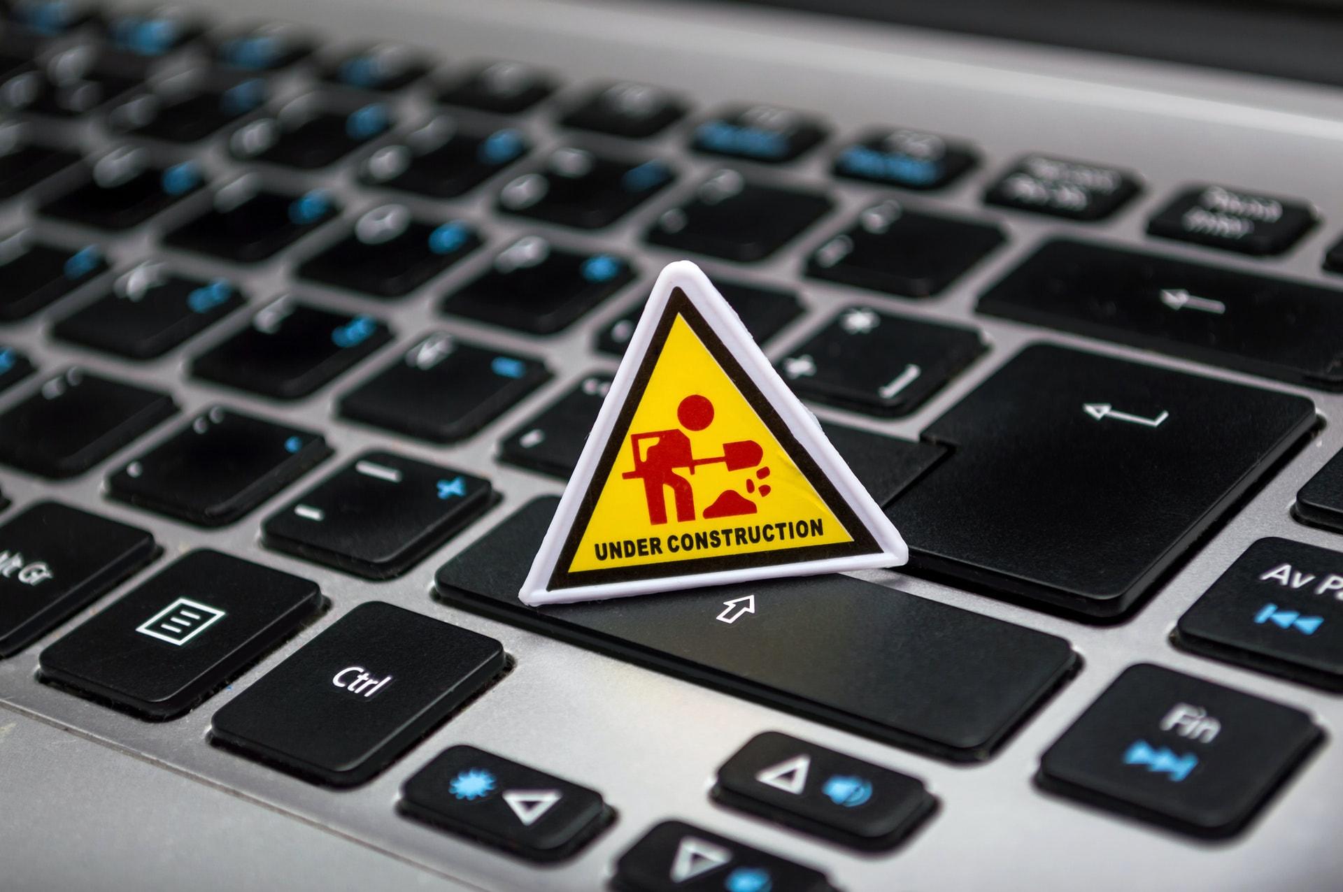 under-construction-signage-on-laptop-keyboard-211122