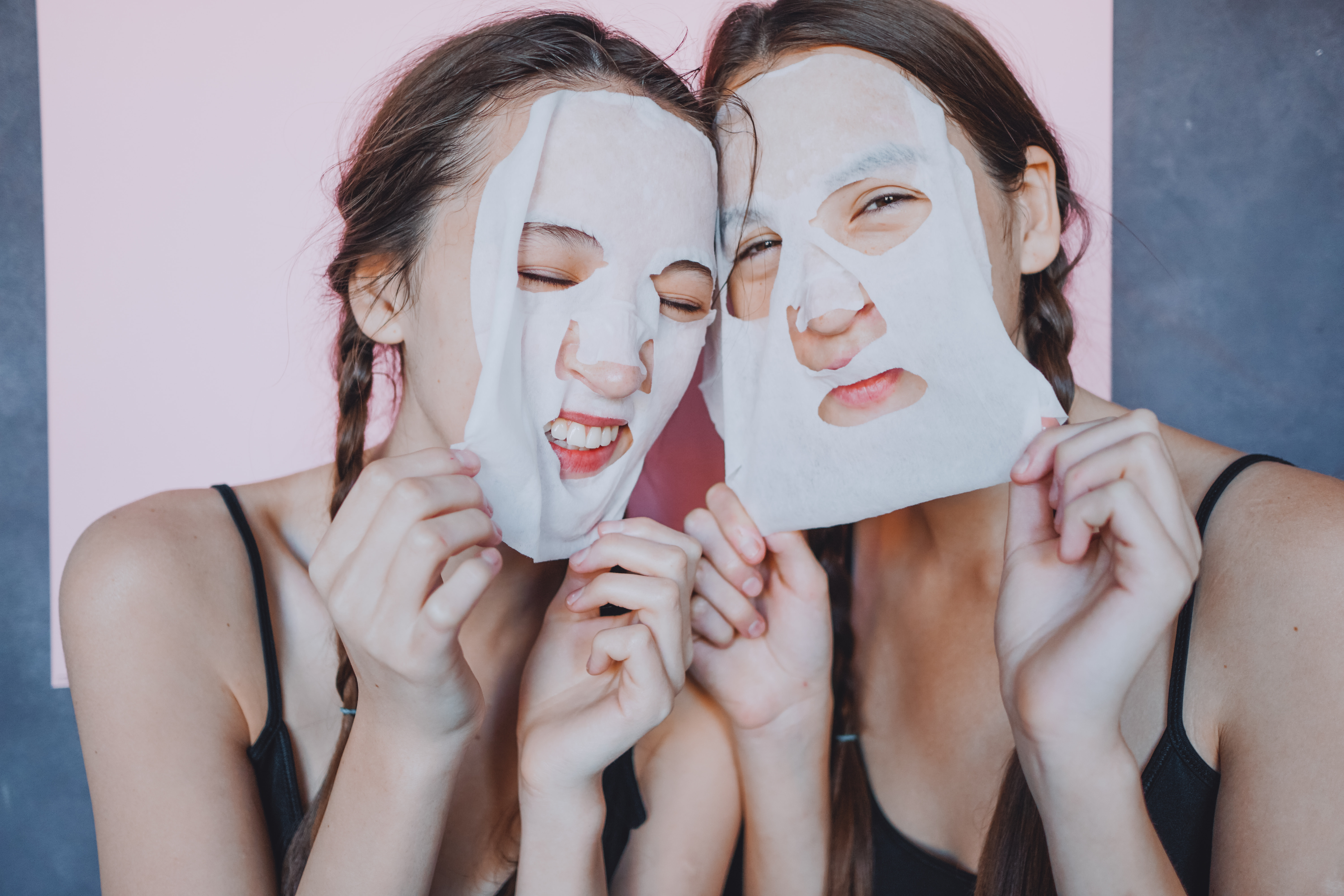 Canva - Young female twins with facial sheet masks