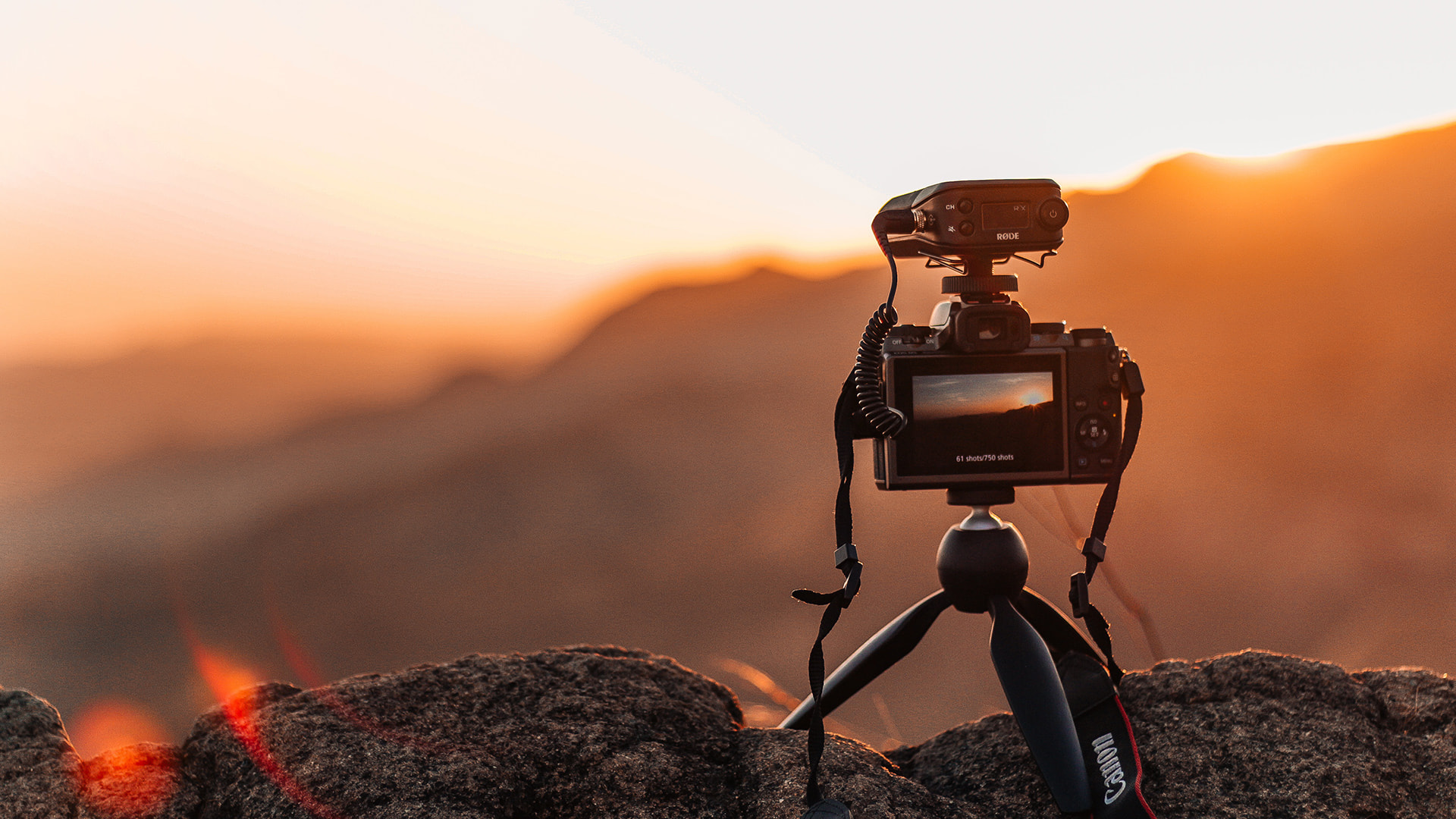 Camera on a tripod taking a photo of sunset