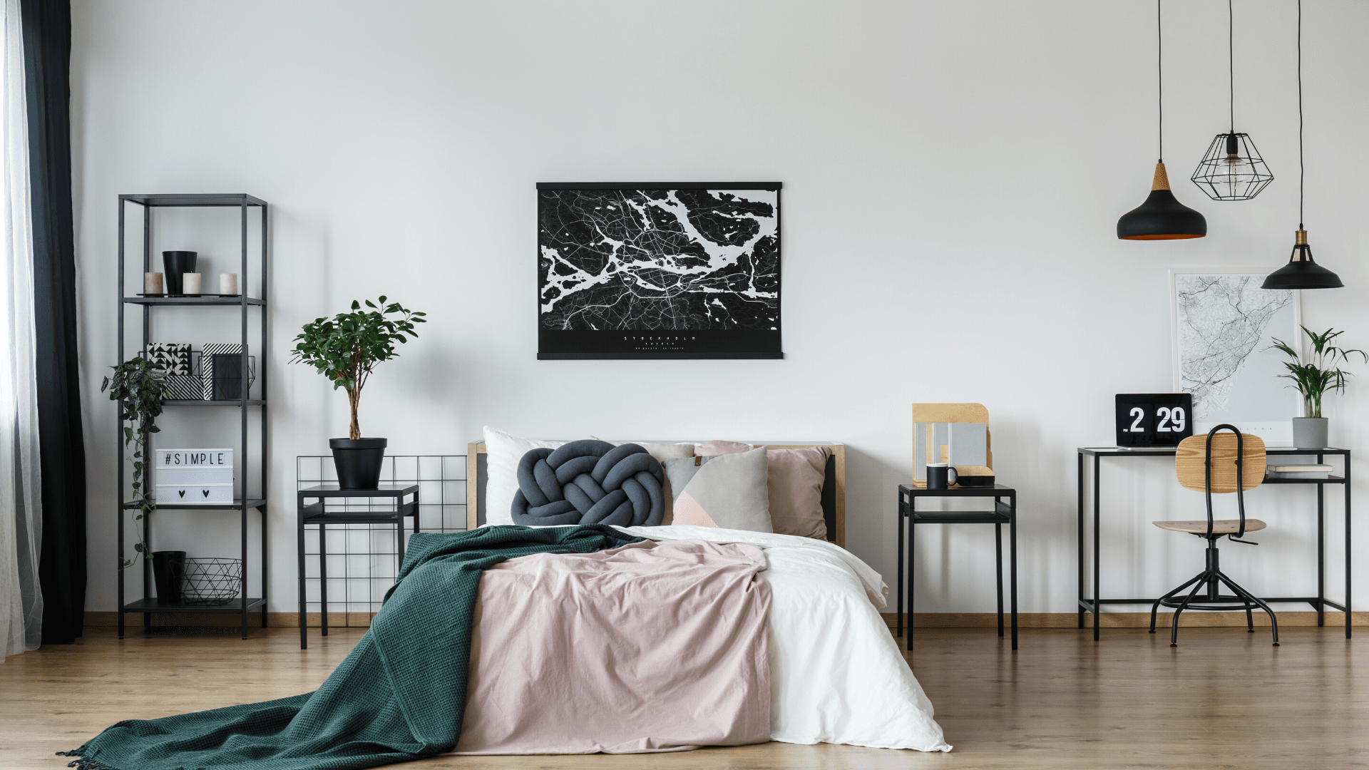 Black map poster above bed