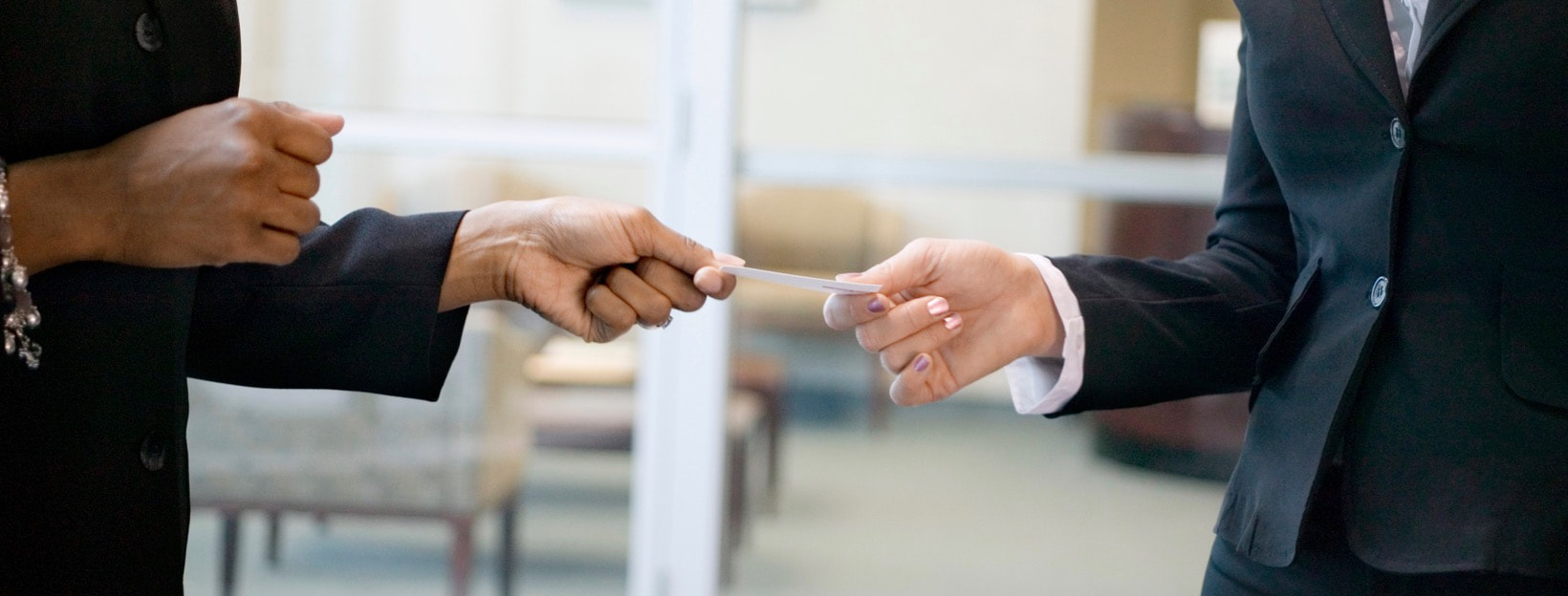 Women exchanging business cards
