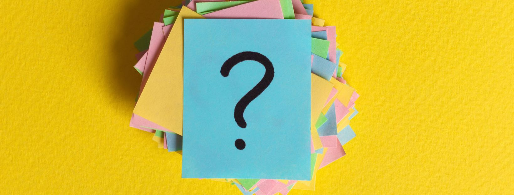 colorful question marks written reminders tickets. ask or business concept