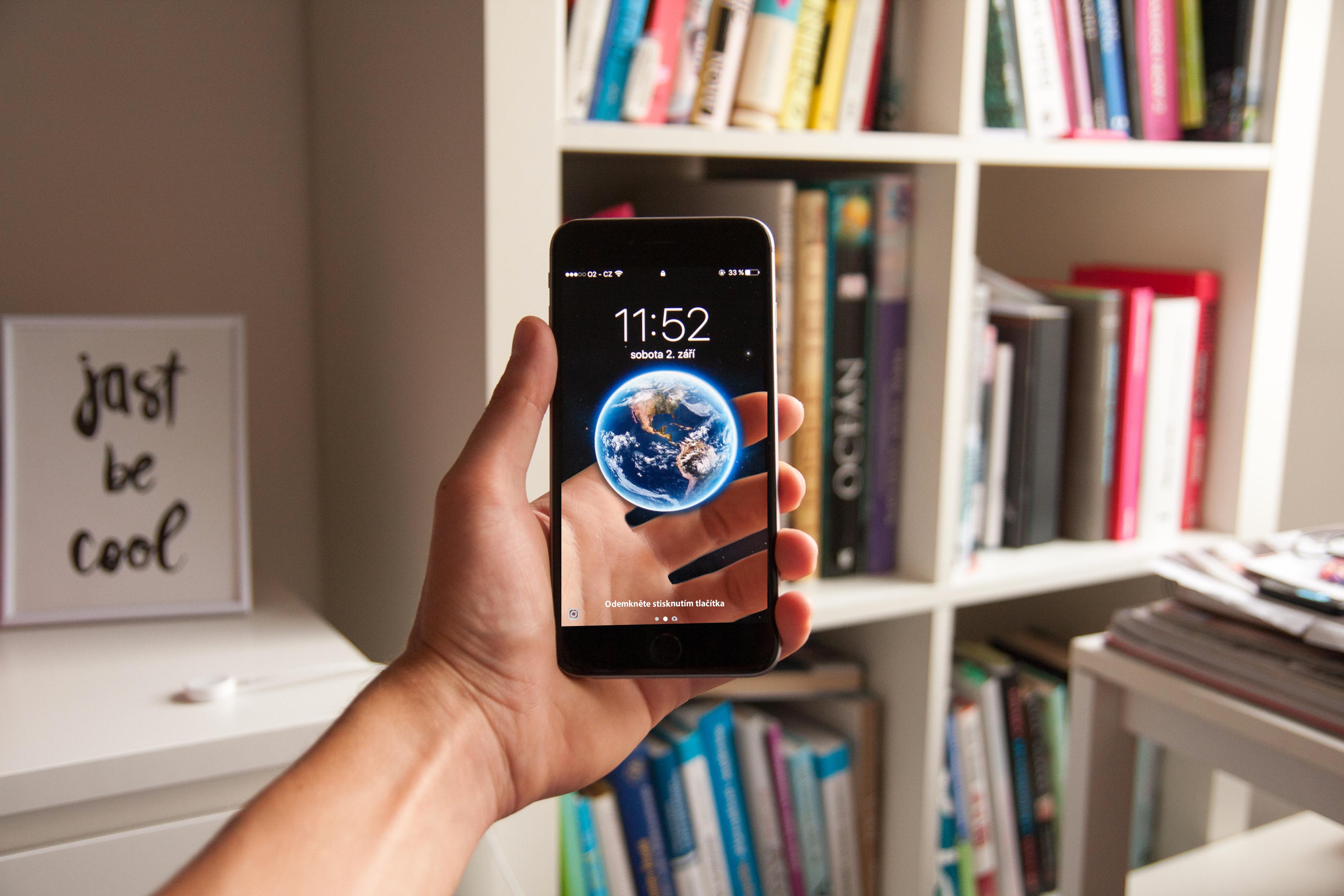Canva - Person Holding Black Smartphone