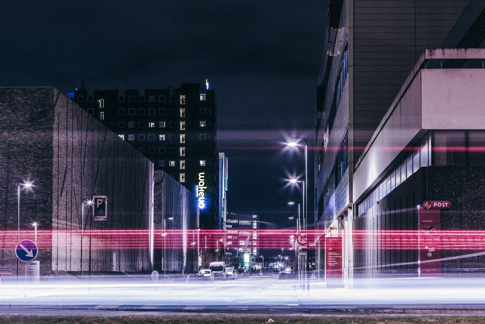 Urban shot of a city street with light streaks by Sandro Katalina
