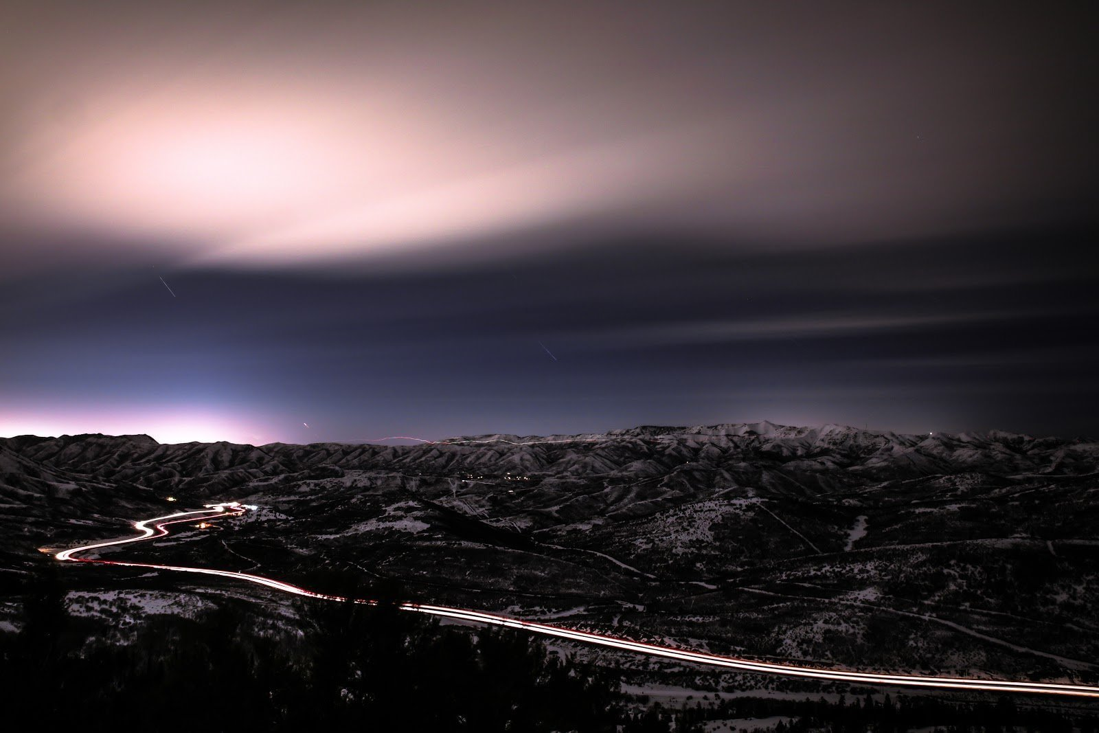 Long exposure of a mountains and a road by Patrick Hendry
