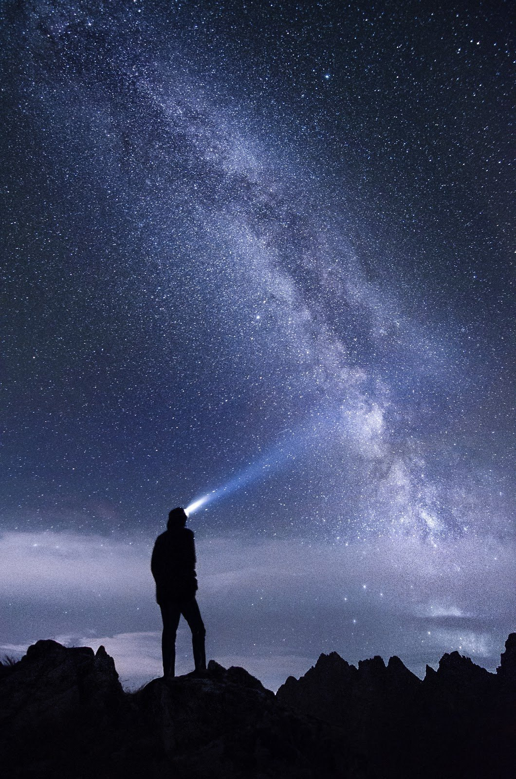 Milky way night sky with silhouette of a person looking up by Stefan Štefan Štefančík
