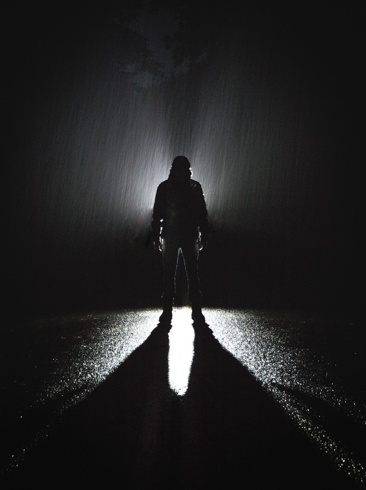 Black and white photo of a man standing in the rain by Steve Halama
