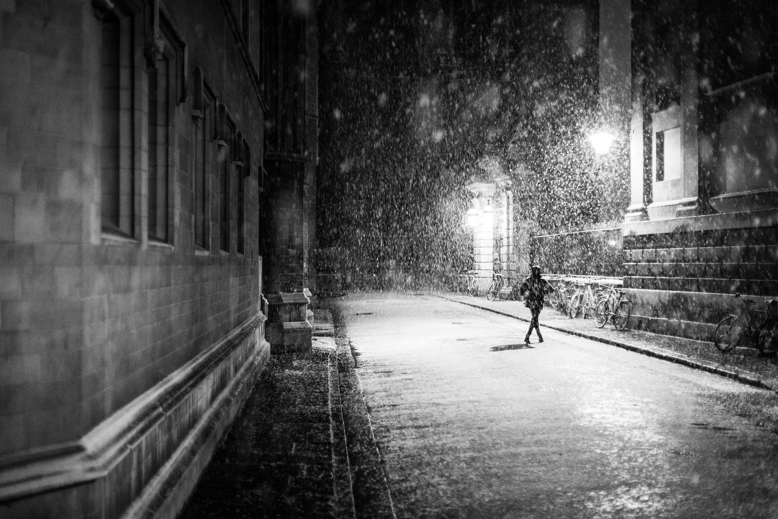 Person running through a downpour by Dominik Schröder