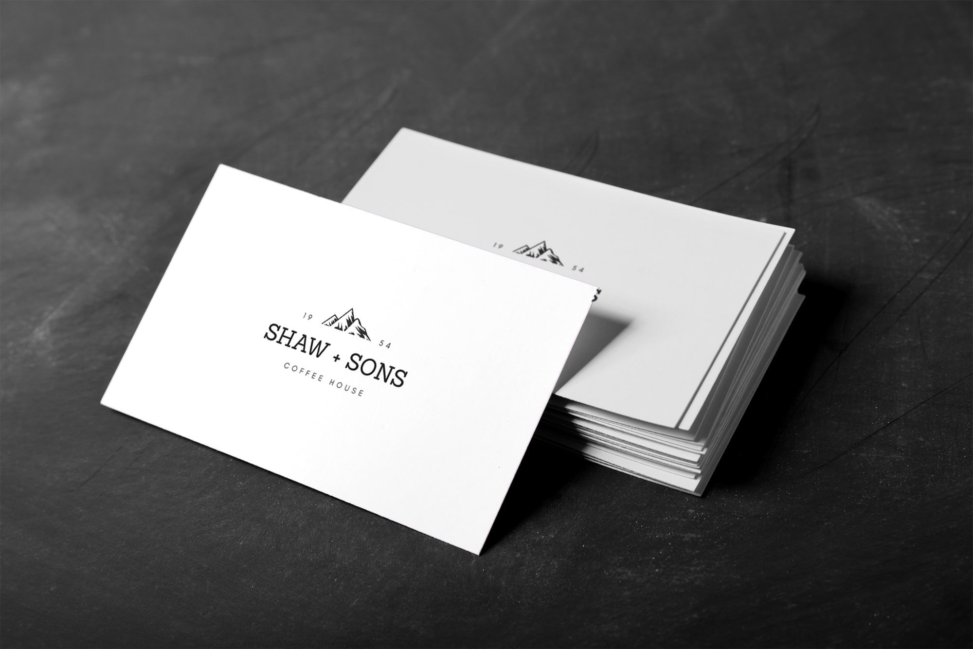 A stack of business cards designed with Canva