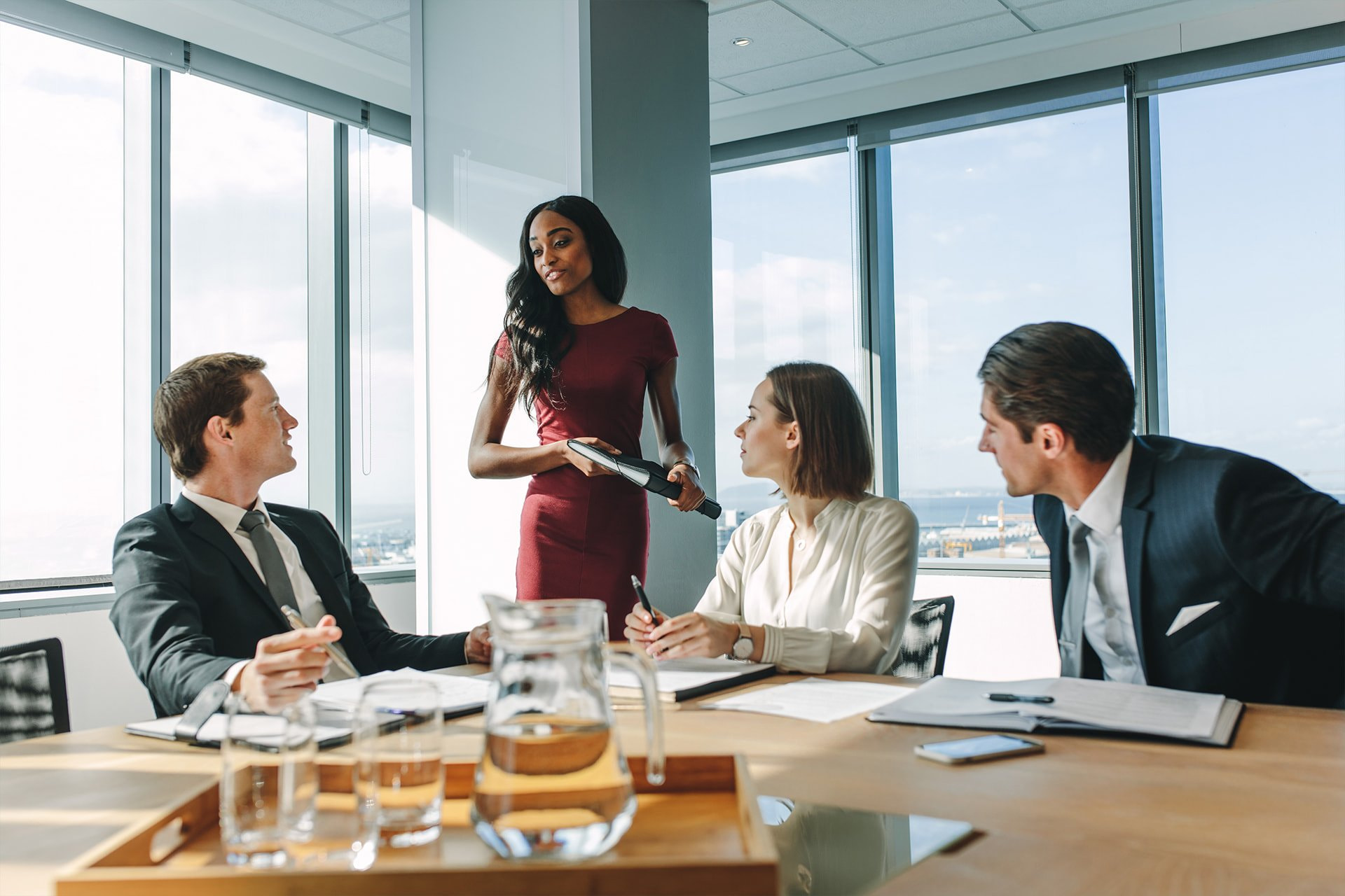 Group of business people talking around a meeting table