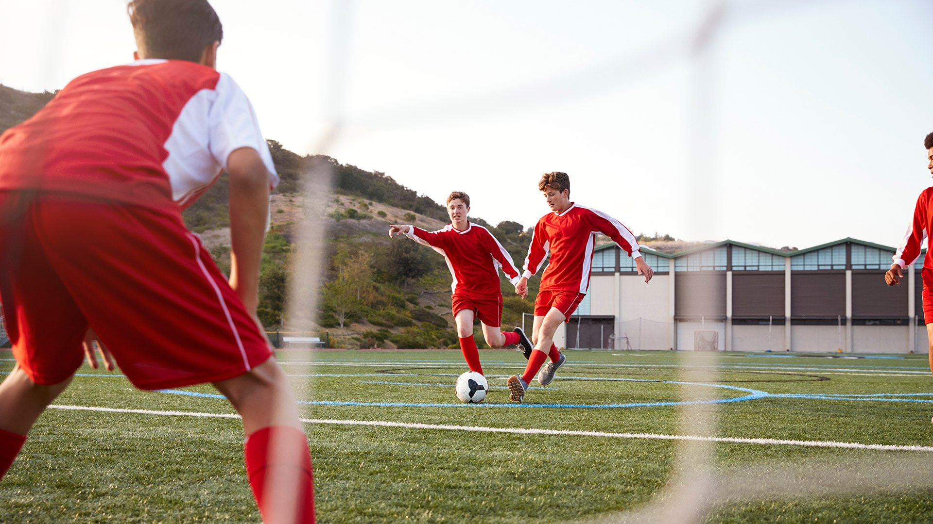 Group-of-Male-High-School-Students-Playing-in-Soccer-Team