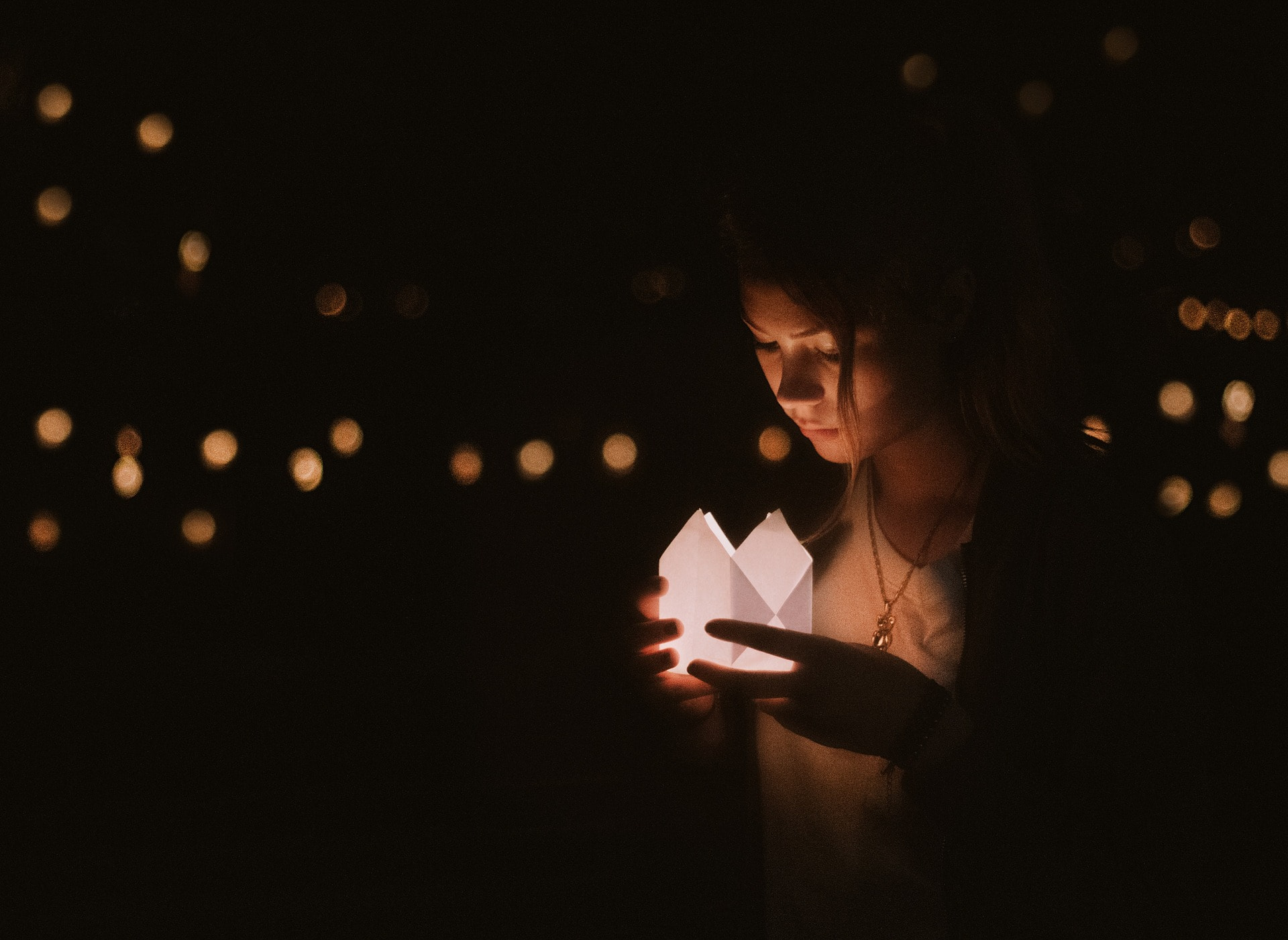 Girl with lantern and bokeh effect