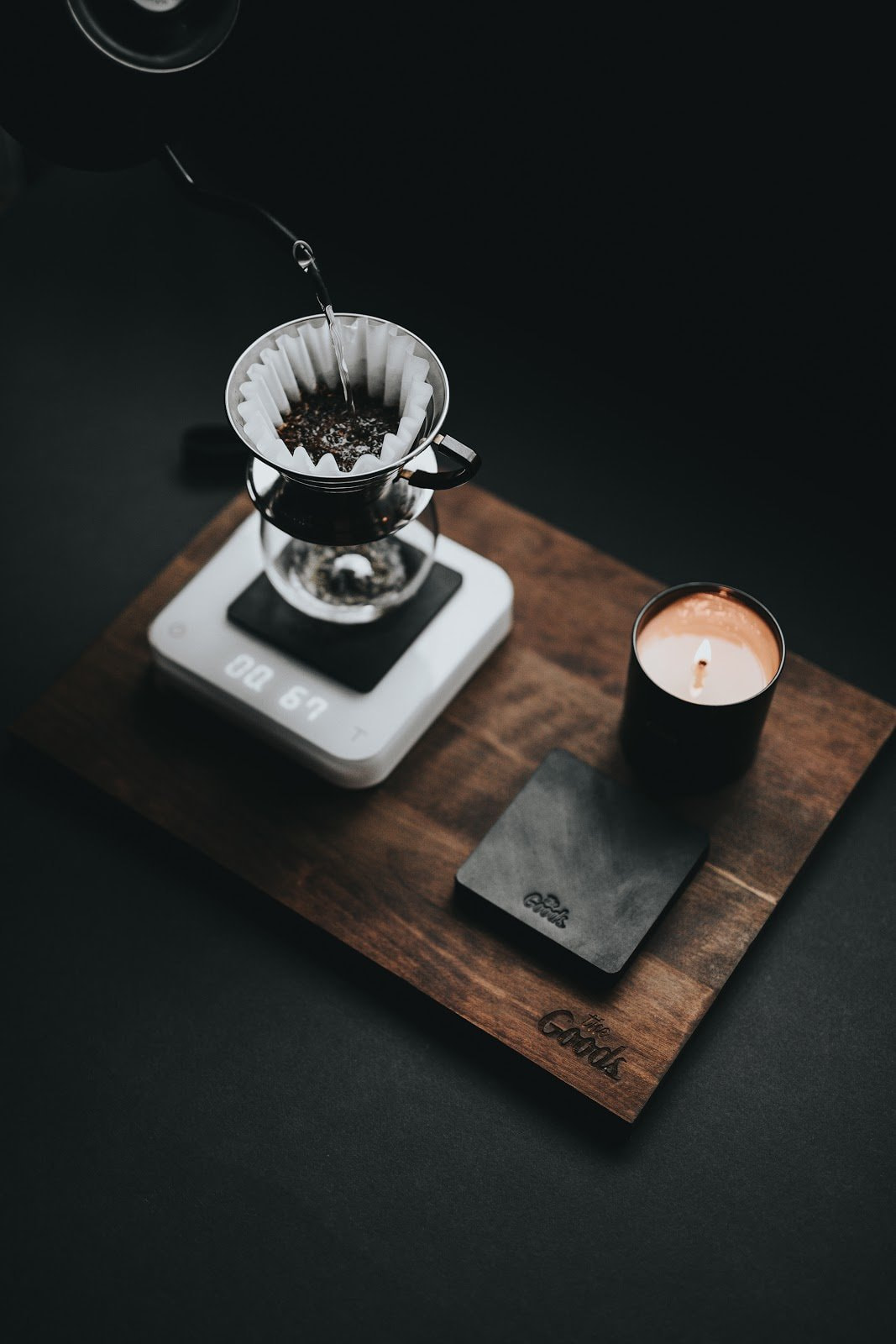 A flatlay of a drip coffee and a candle by Nathan Dumlao