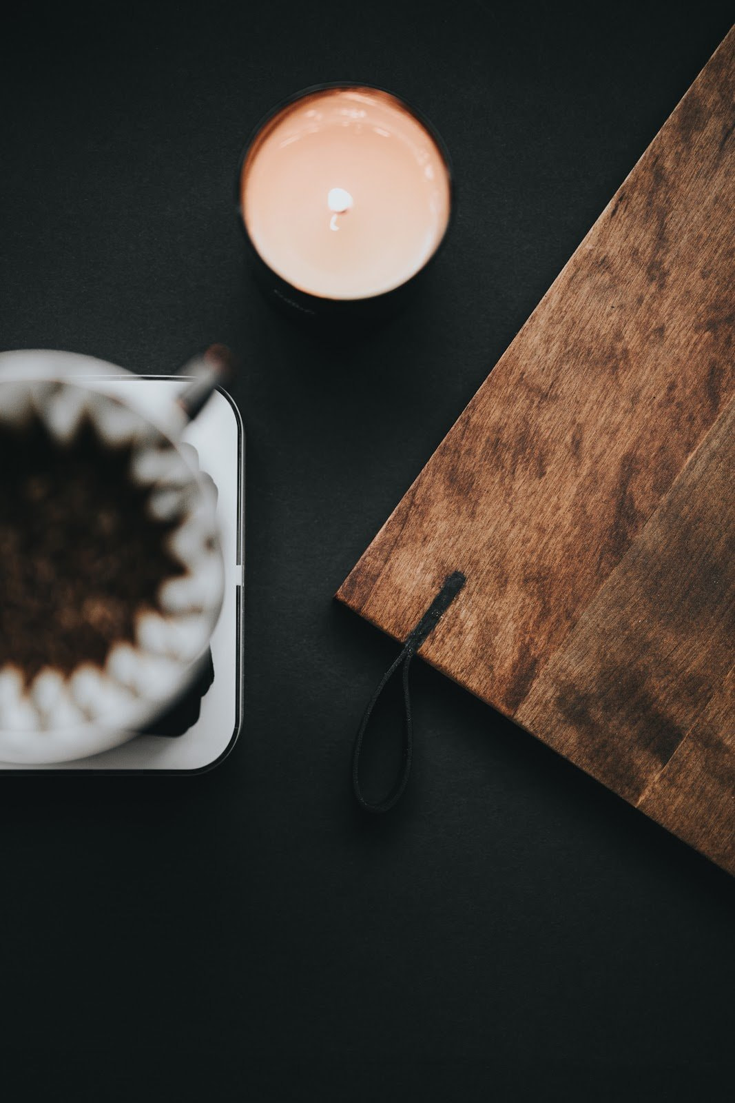 Candle, drip coffee and wooden tray by Nathan Dumlao