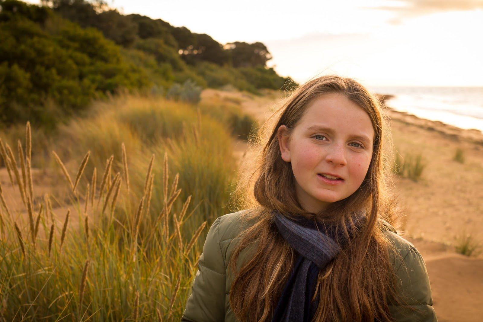 Portrait of a girl against a coastline by Cohen Van der Velde