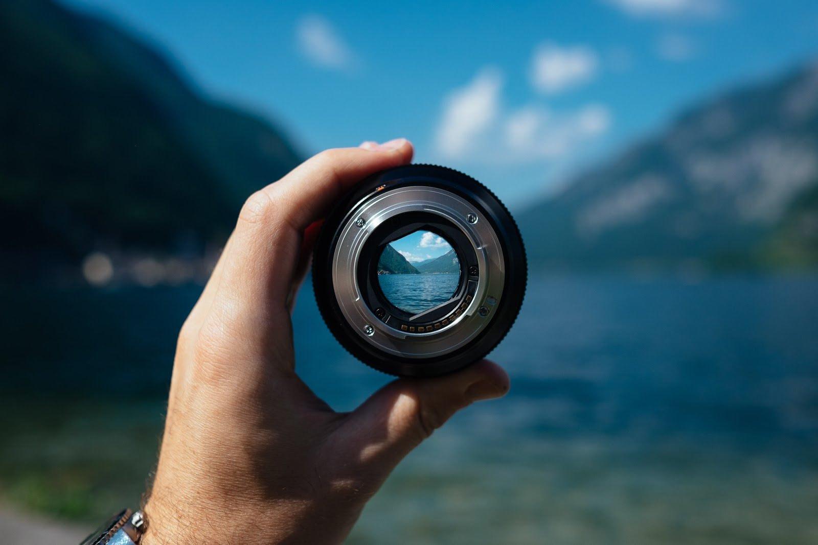 Lake and mountains seen through a camera lens by Paul Skorupskas