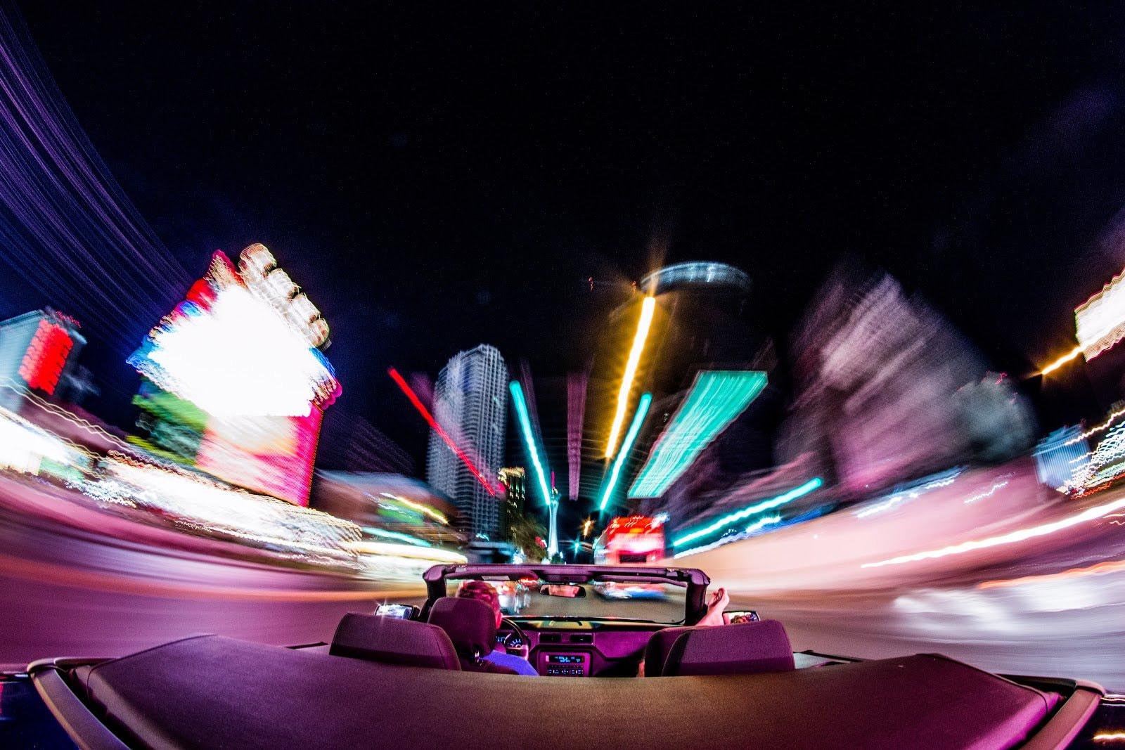 Blurred city lights taken from a car by Jakub Gorajek