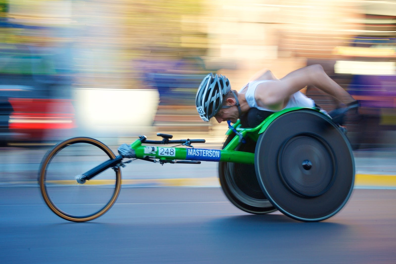 Motion blur photo of a disabled cyclist by Seth Kane