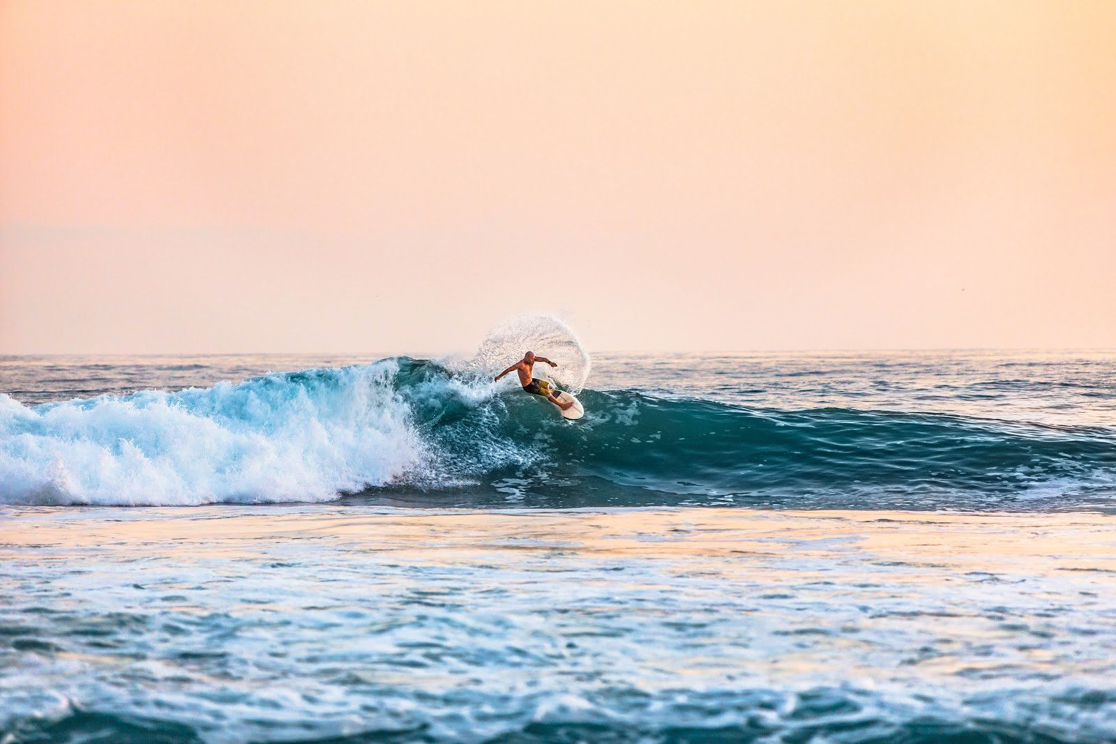 Surfer action shot by Teddy Kelley