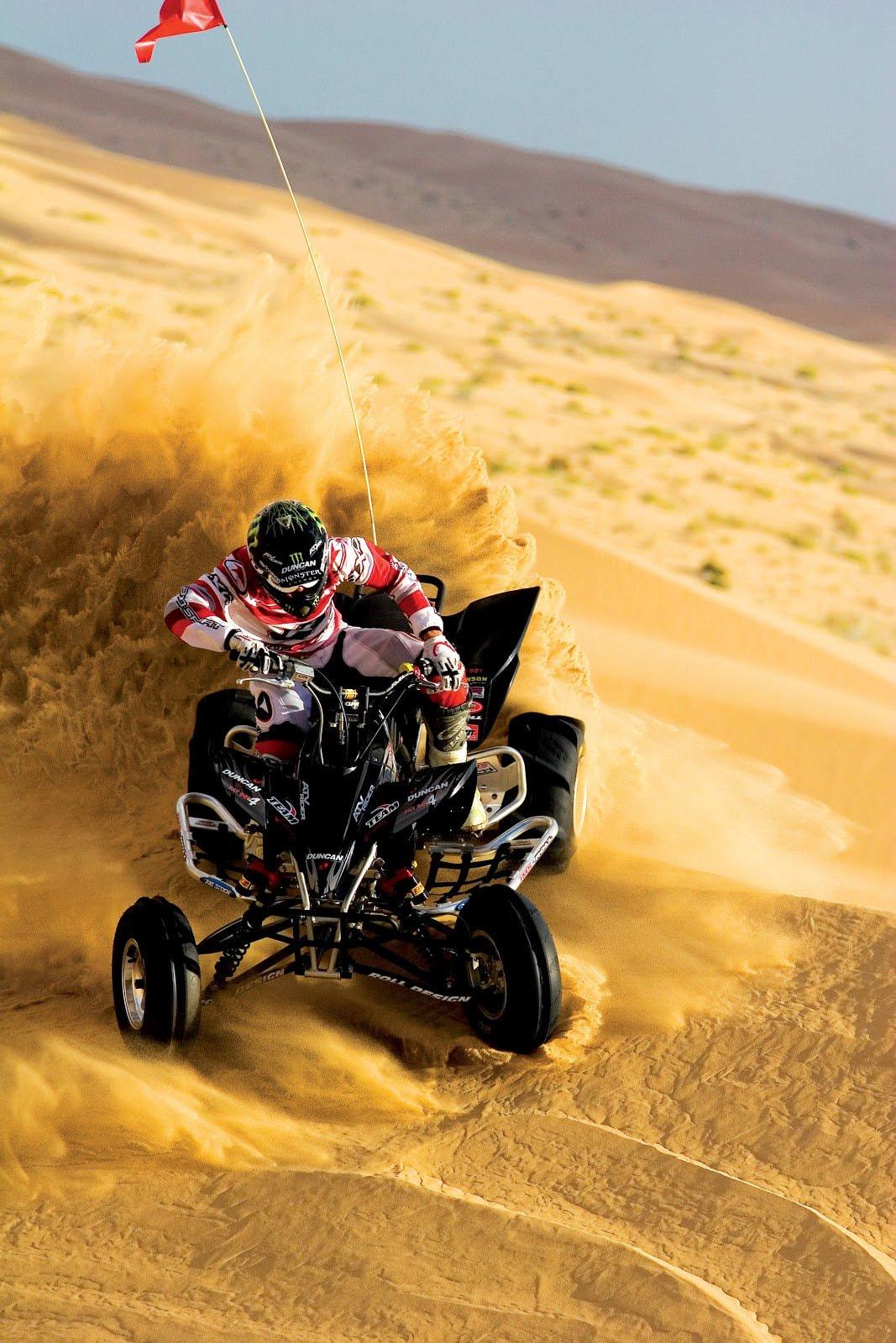 Dirt bike rider action shot by Joe Neric