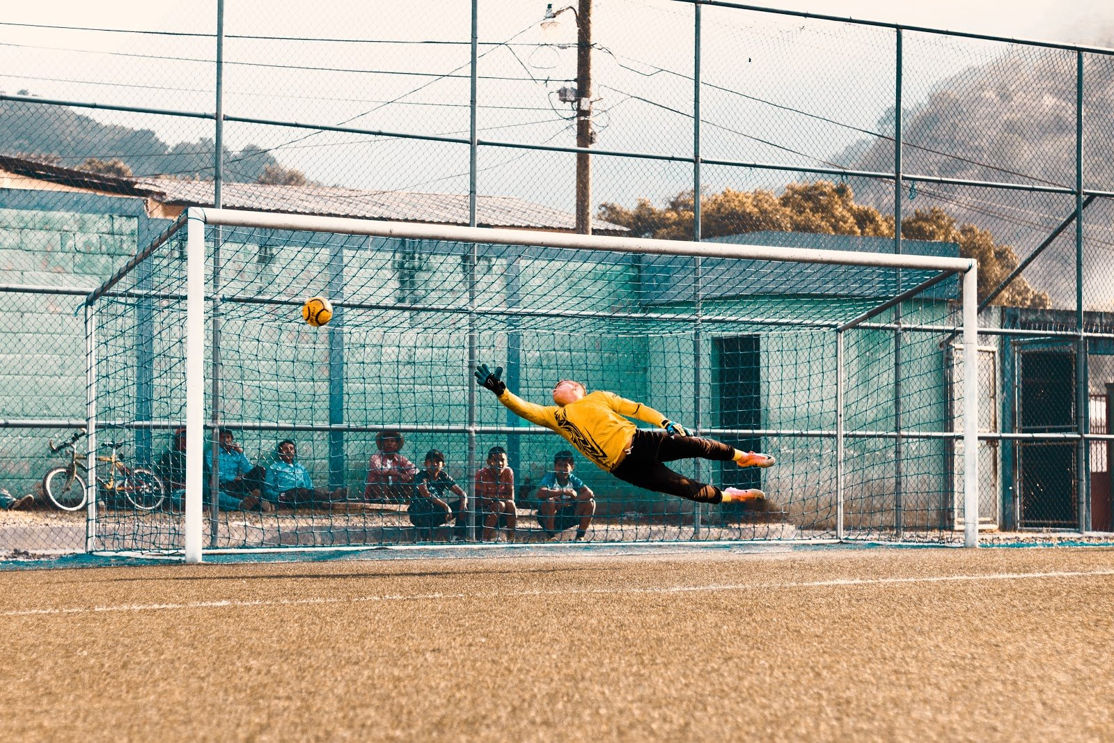 Action shot of a goalie blocking a ball by Alvaro Mendoza