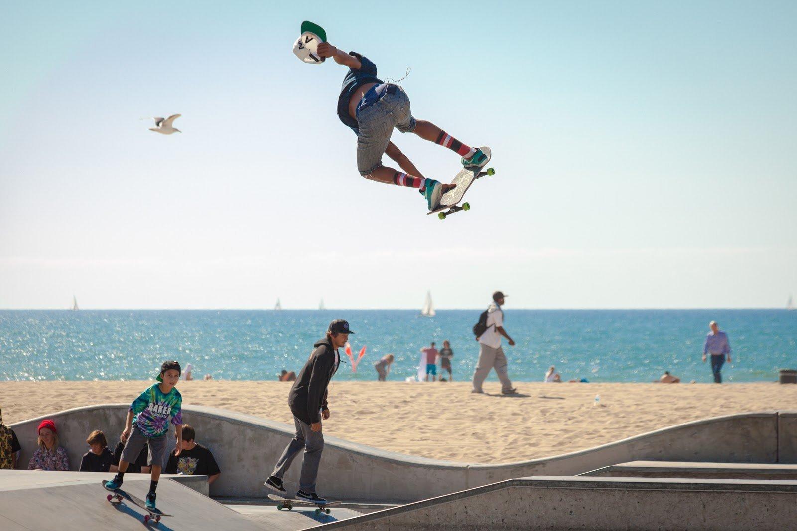 Skateboarder doing airtime by Chris Brignola