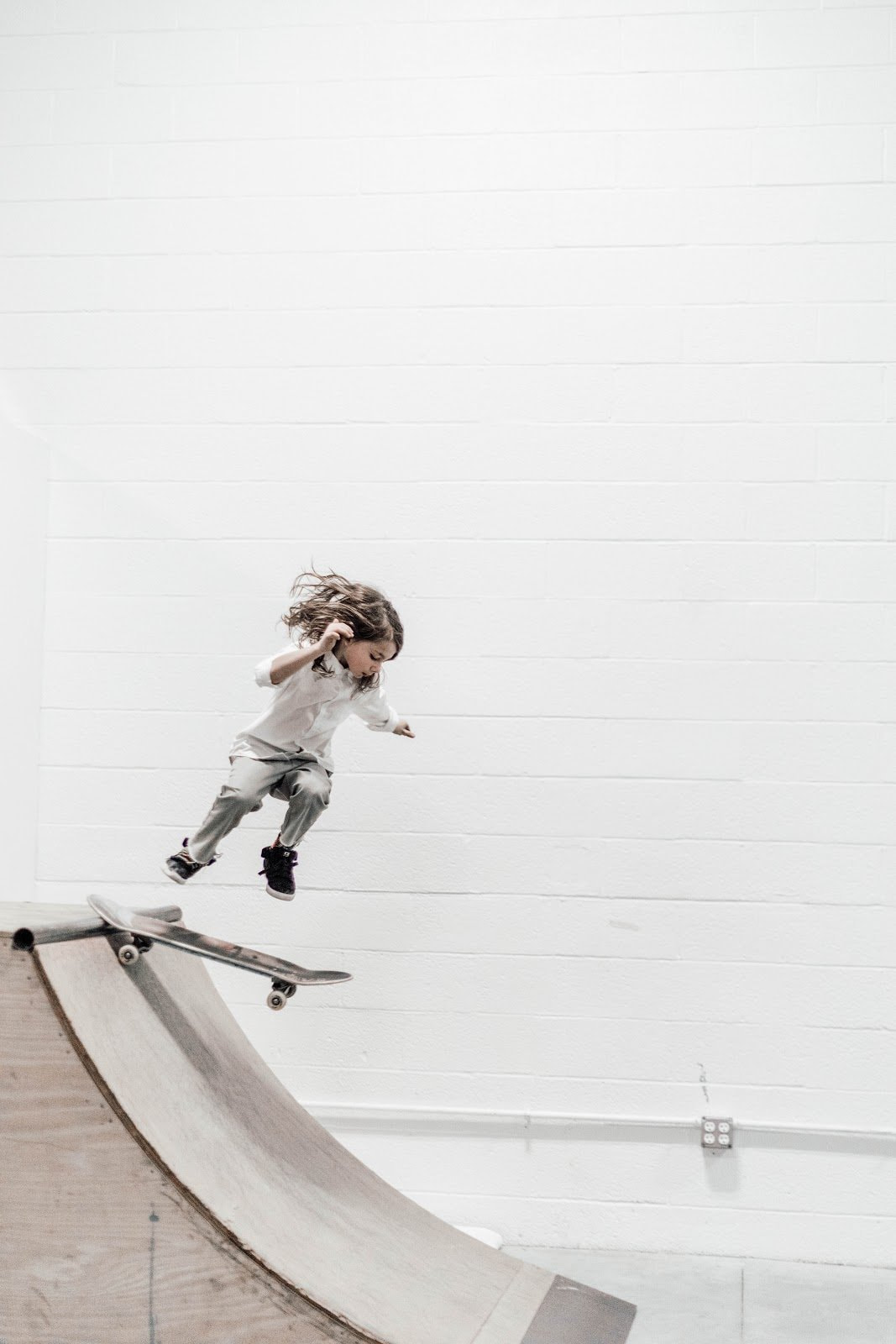 Action shot of a young skateboarder by Emily Reider