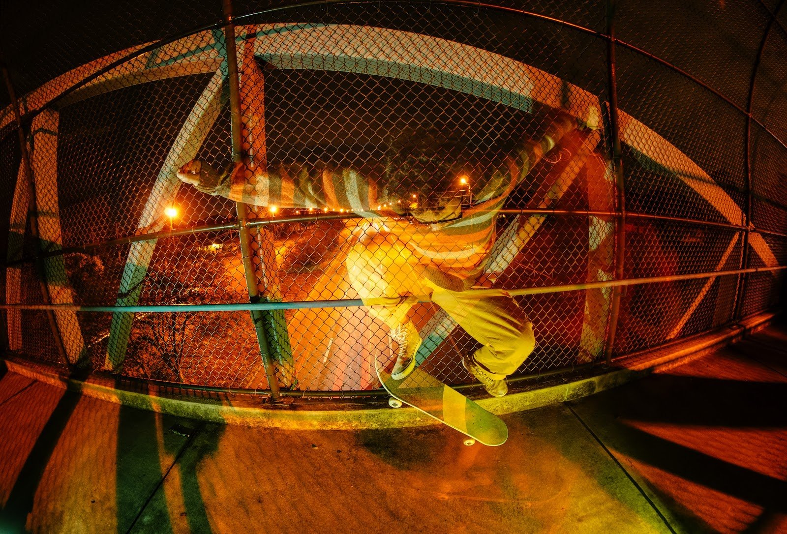 Fisheye action shot of a skater doing a trick by Chad Verzosa