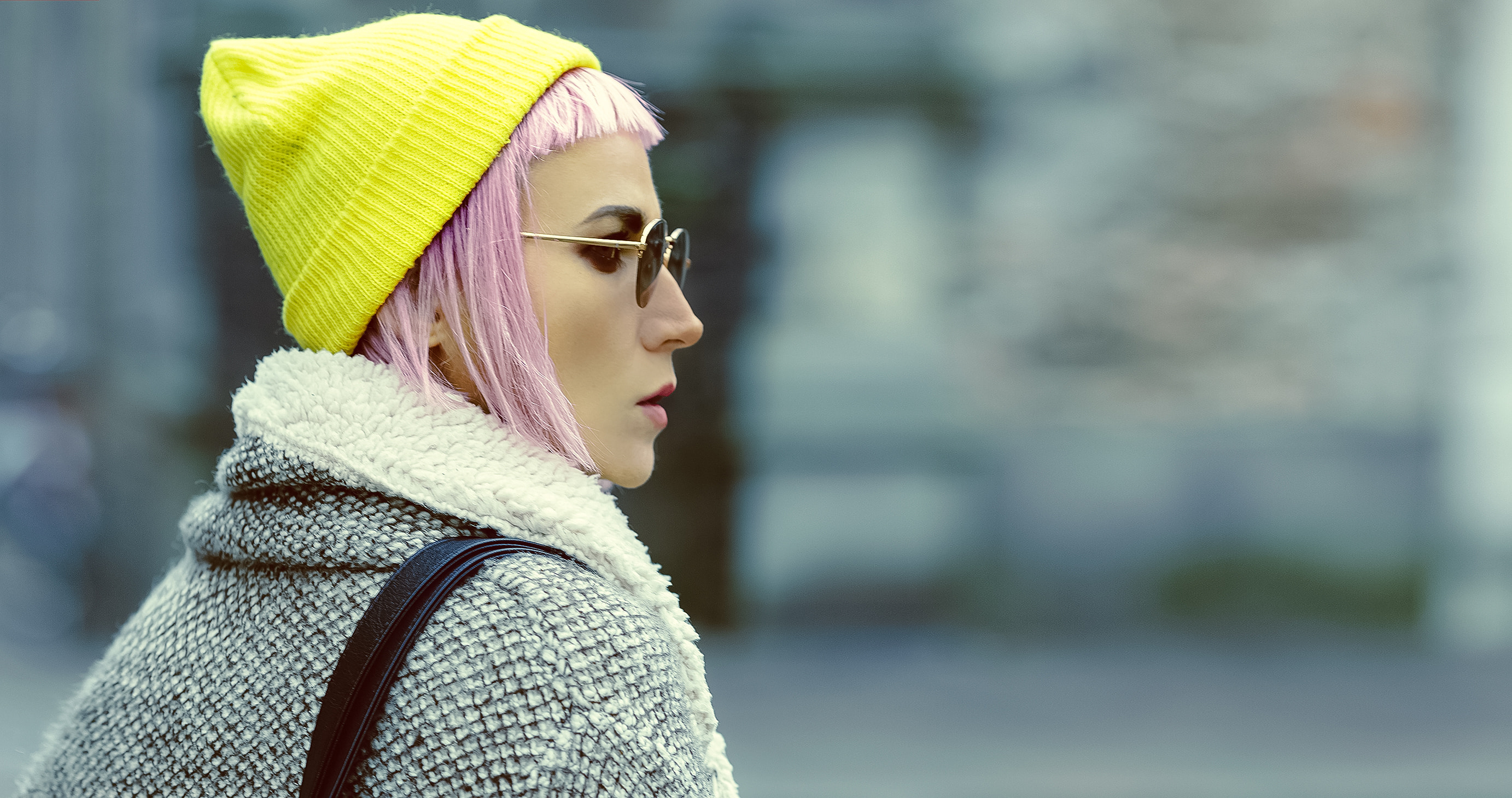 Stylish girl with pink hair on the street. urban fashion