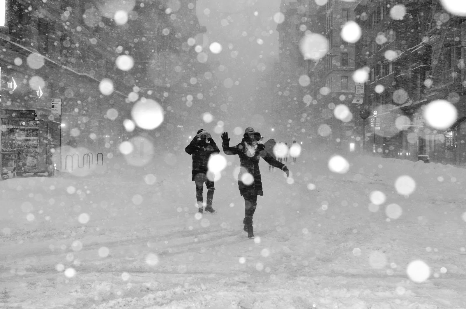 People walking through a snow storm by Jeffrey Blum
